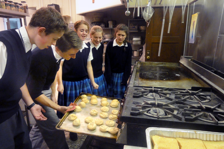 Students assist in the kitchen for the Fatima Conference banquet.