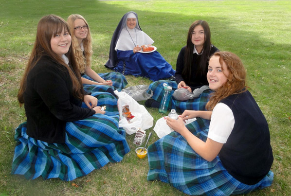Sister with girls of St. Michael's Academy